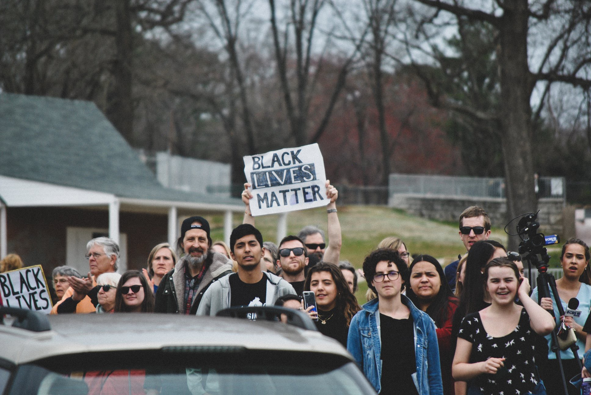 Walkout participants gather in McIntire park on the edge of 250 bypass, 2019. (Photo by Locs Image Photography)