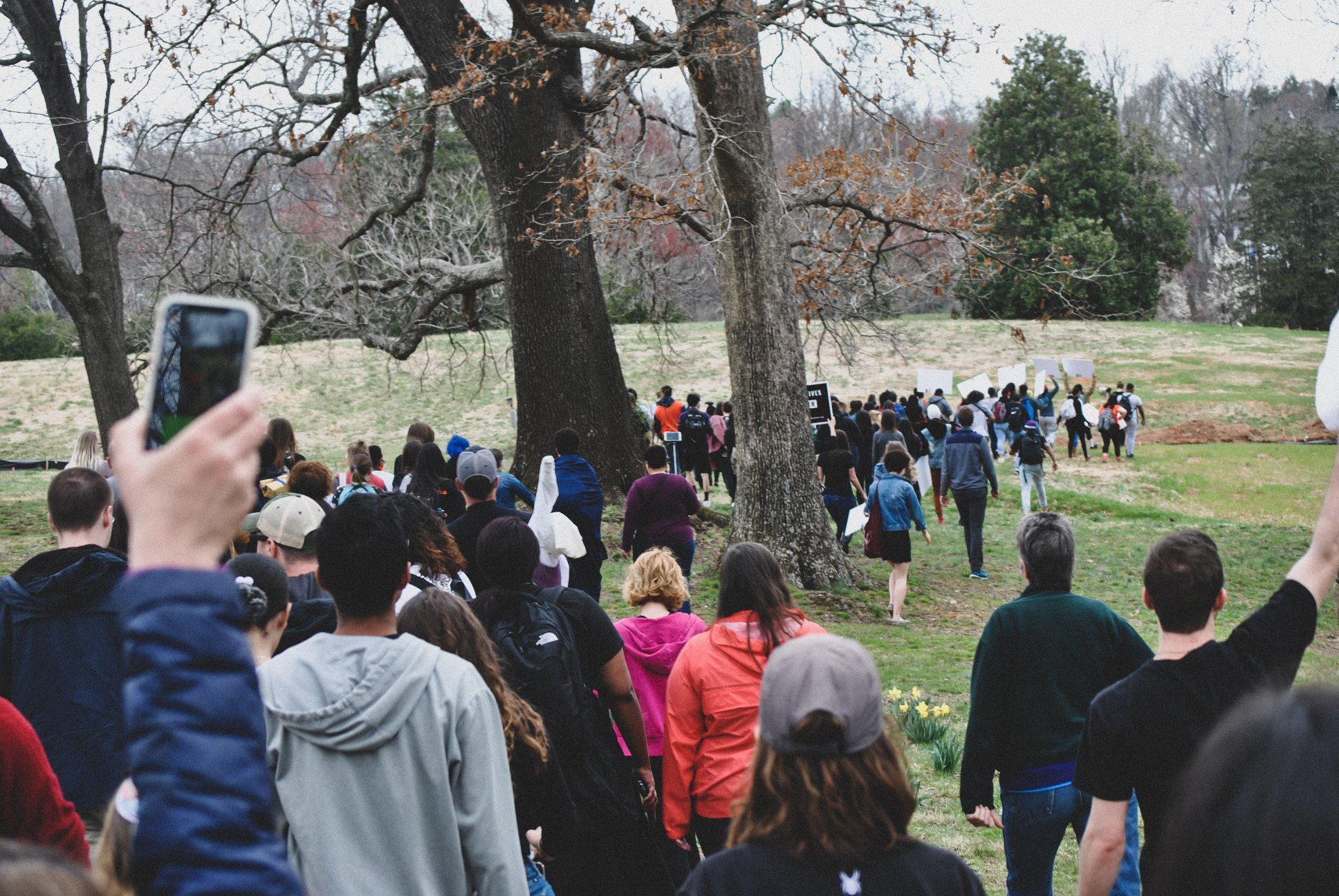 Hundreds of Students and Community members walk through McIntire park to final rallying point, 2019. (Photo by Locs Image Photography)