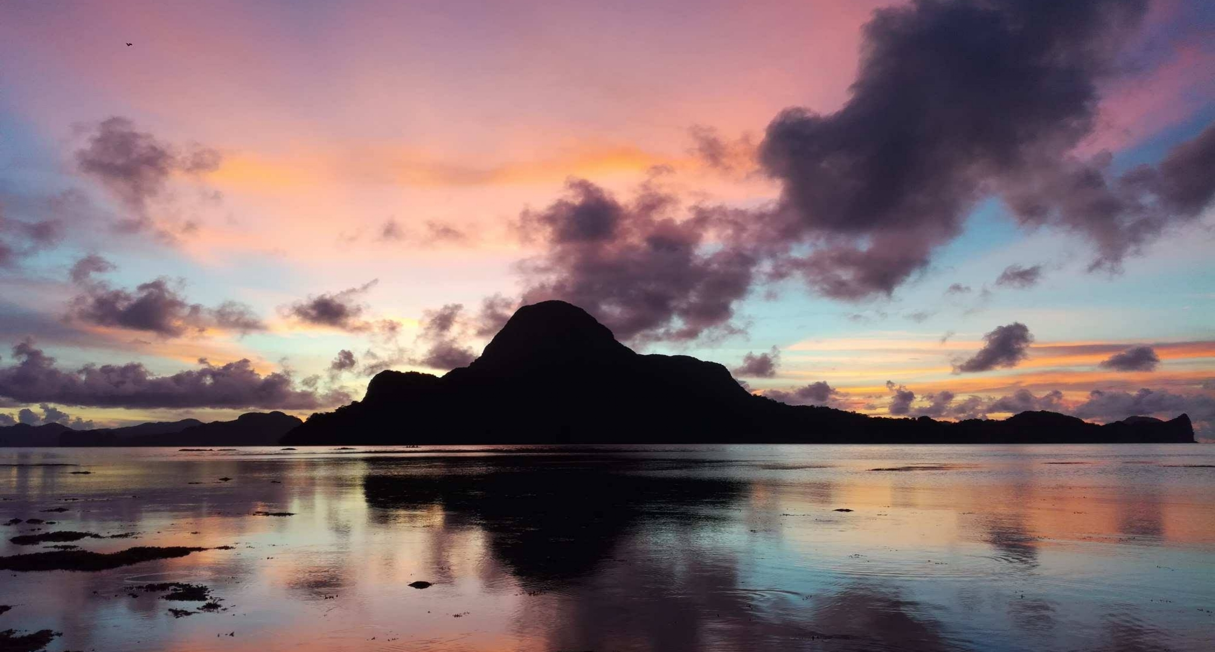 Catch the best sunset - Head to Caalan Beach (a 30-min walk from town) and admire a gorgeous view of Cadlao Island joined with a unique mix of colors. No filter needed.