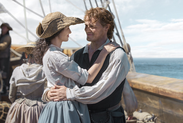 Jamie and Claire embrace on ship.jpeg