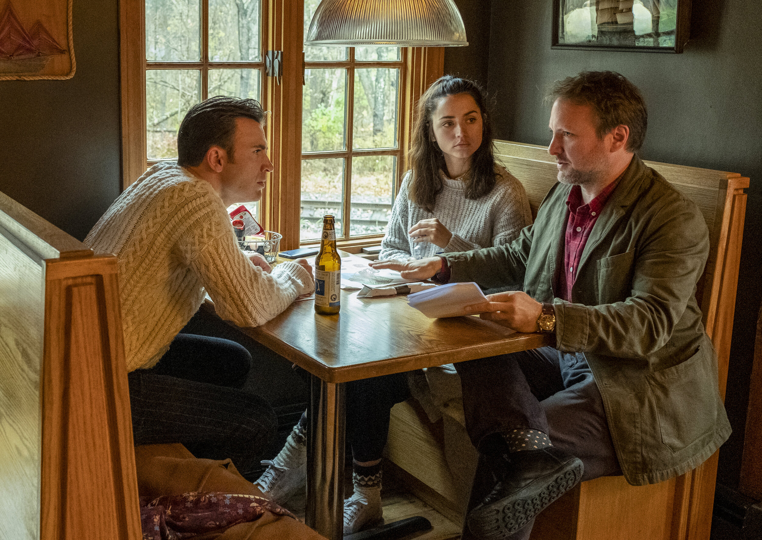 """Chris Evans, left, Ana de Armas and director Rian Johnson on the set of """"Knives Out."""" (Claire Folger /Lionsgate)"""
