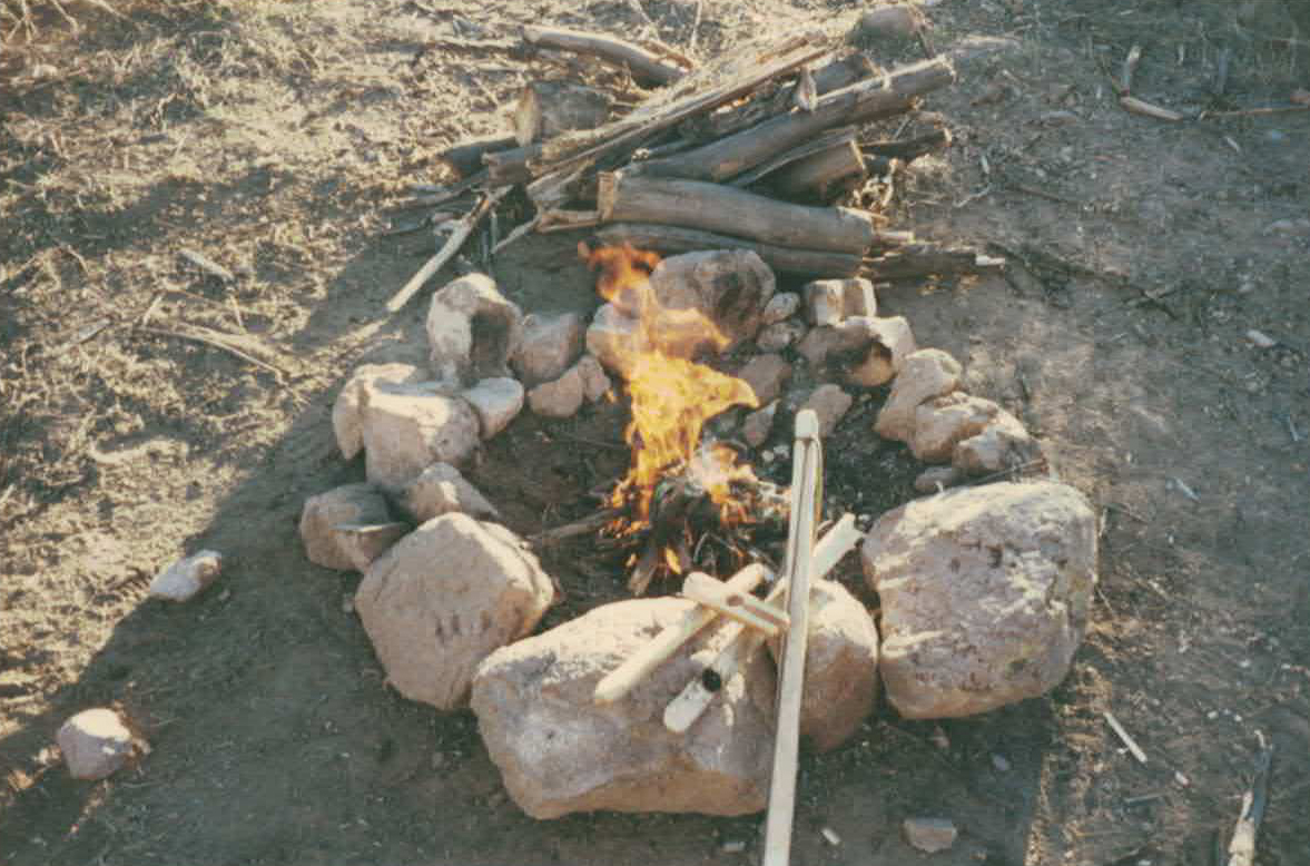 FIRE MADE WITH BOW DRILL MADE ON THE TRAIL