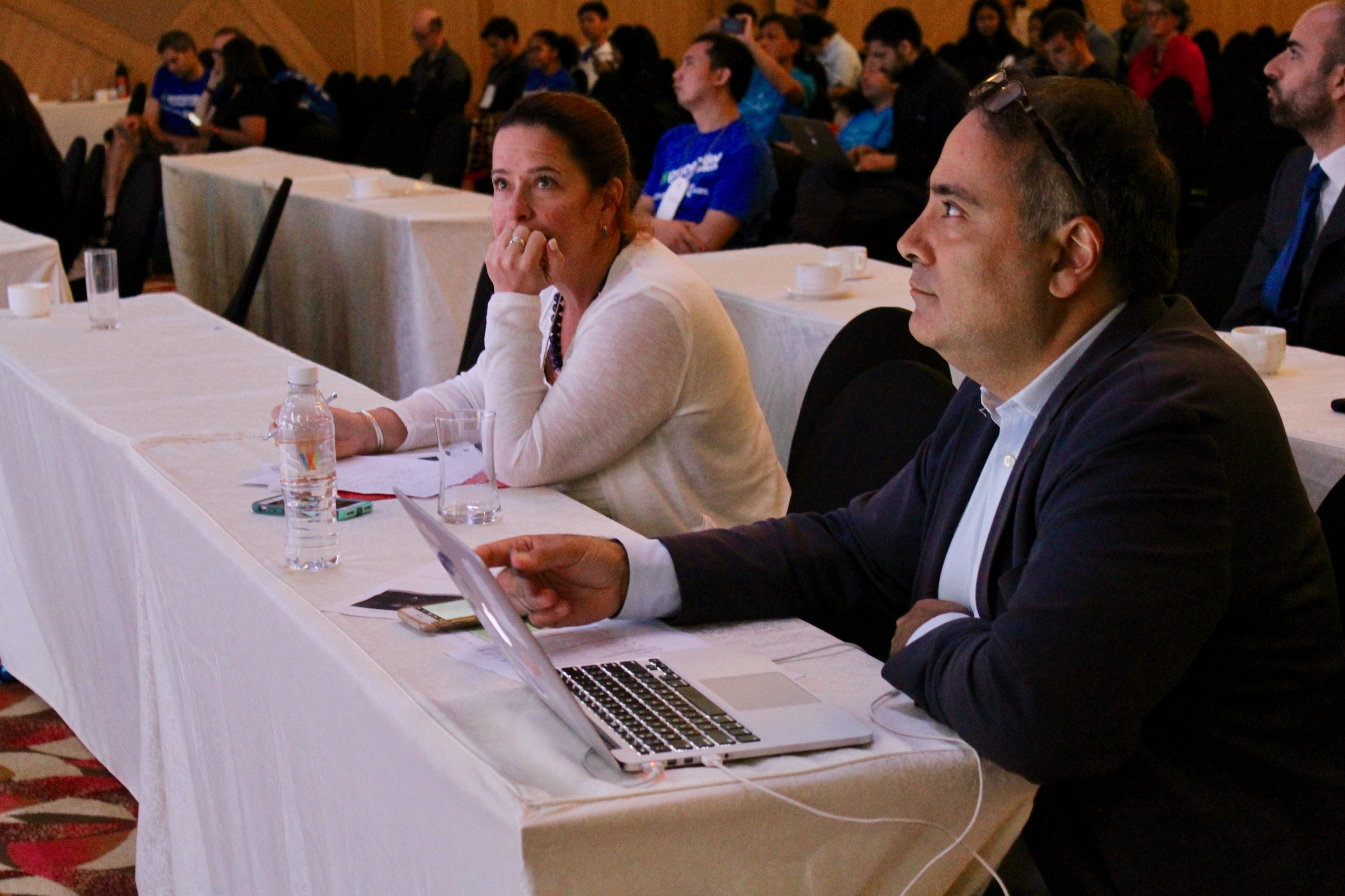 Judges participate in the final pitch session. 2018