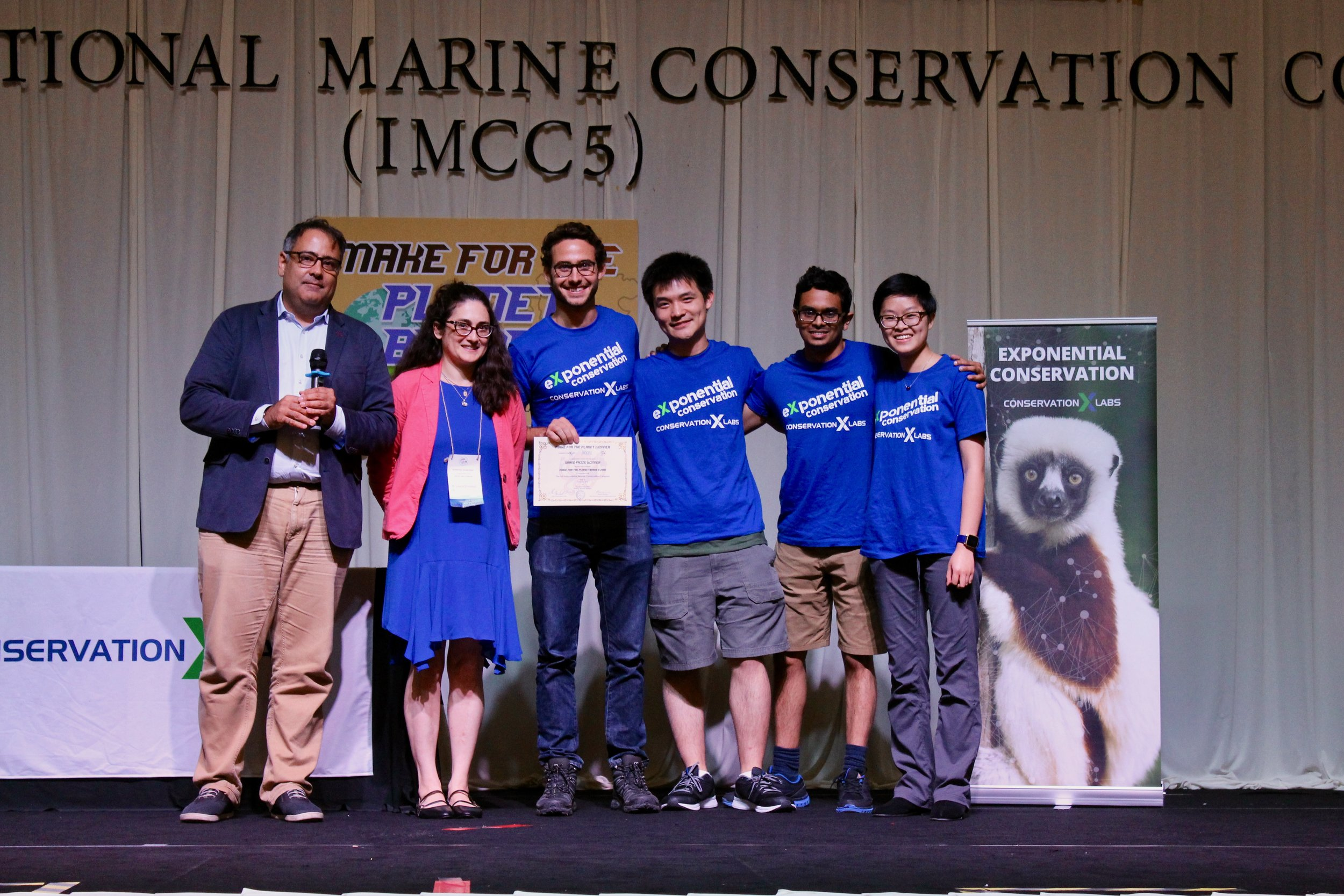 The LobsterLift team accepts the grand prize award at Make for the Planet Borneo. 2018