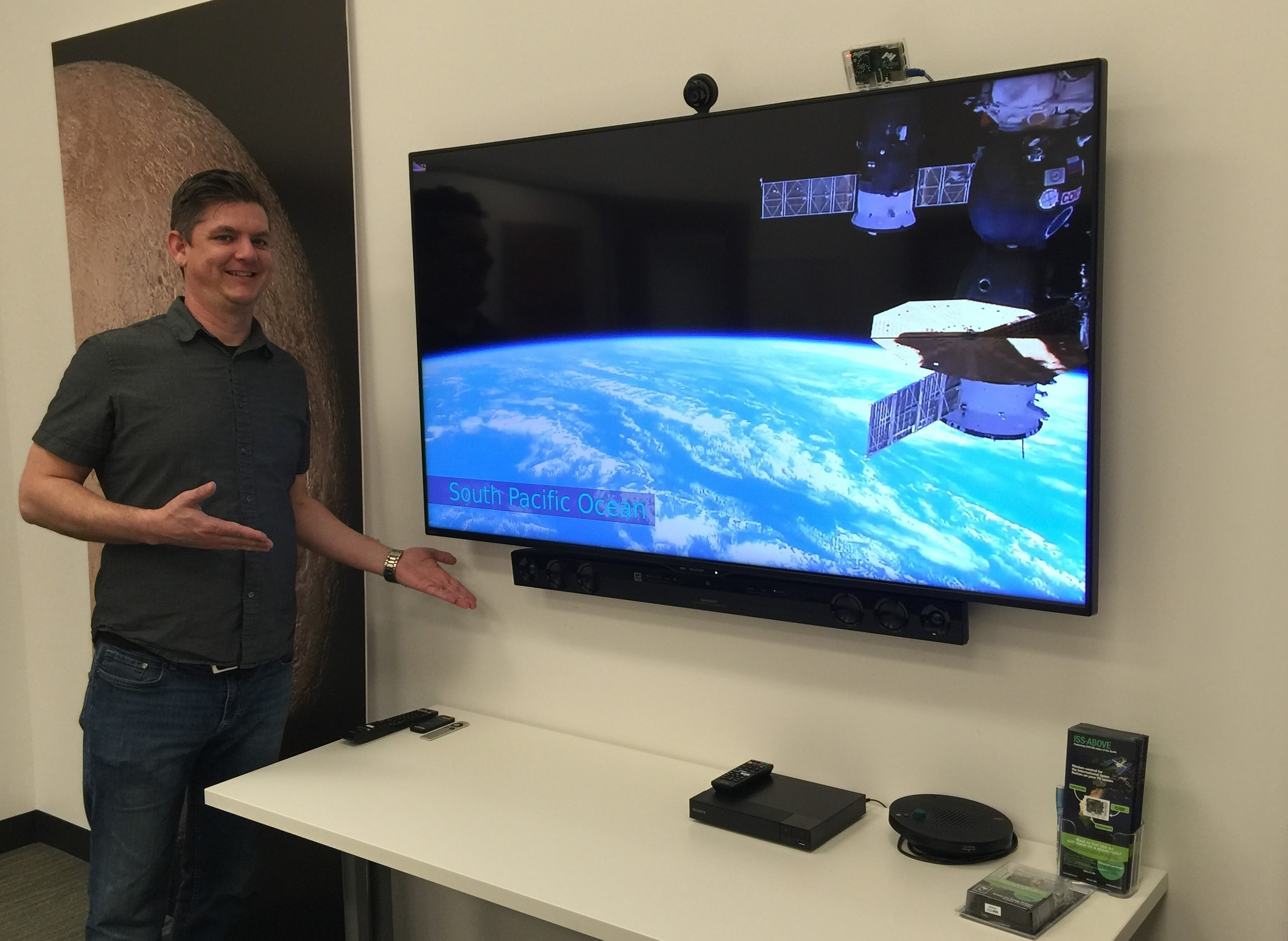 Brandon Shoelz standing beside the ISS-Above / TV