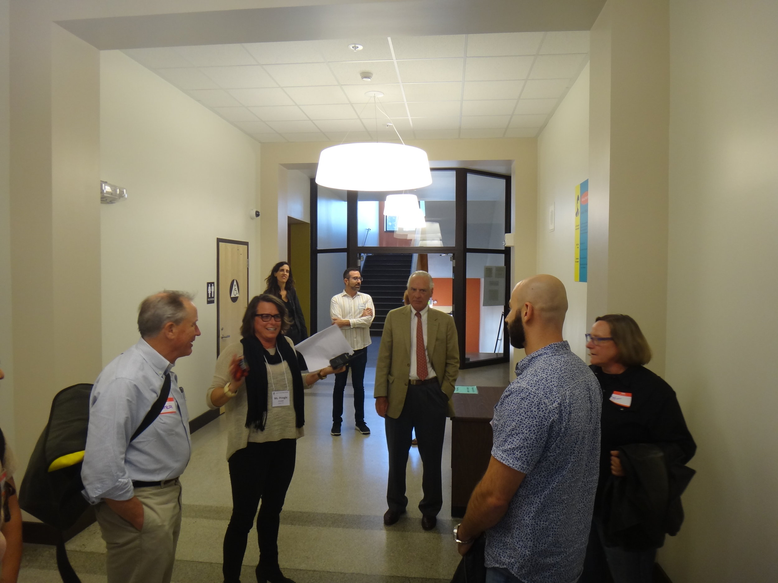 Principal Katie Pringle greets guests to the Ida B Wells Open House in the corridor at the crossroads of the remodeled entrance and administrative offices.