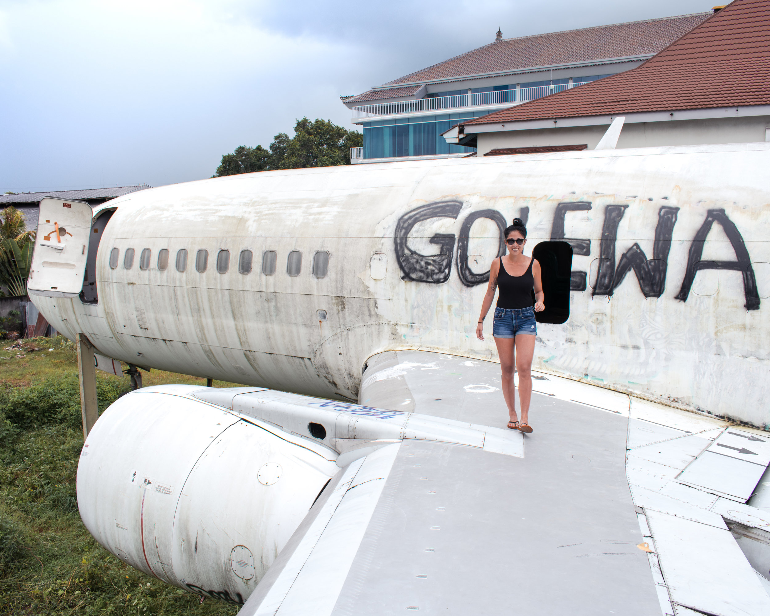 Standing on the wing of an abandoned plane in Bali, Indonesia