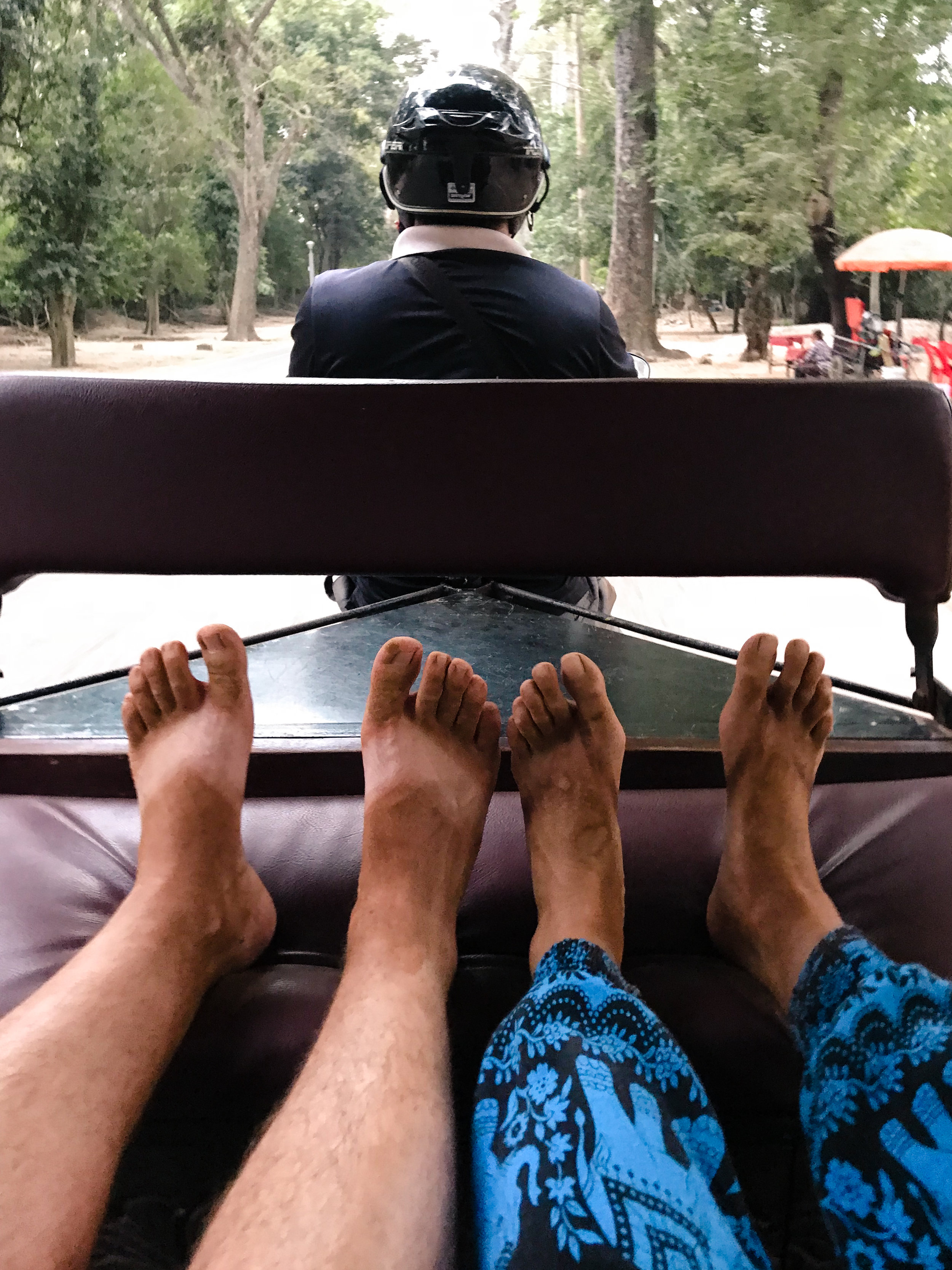 EW, feet? Gross. Double gross that they're orange by the end of a day at Angkor Wat.