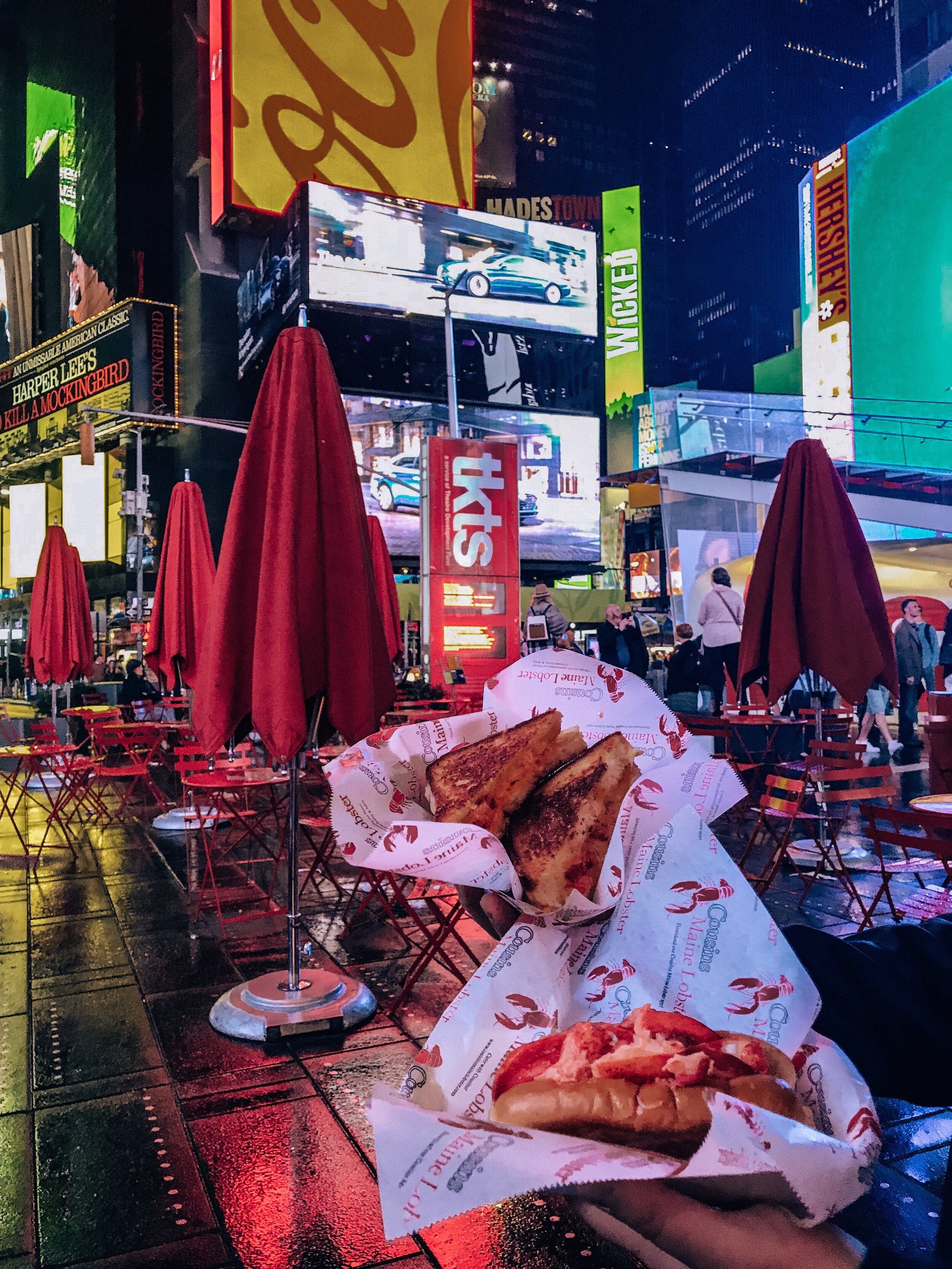 A lobster grilled cheese sandwich and lobster roll in the middle of Times Square. The most expensive sandwiches we've ever had 😳And so worth it.