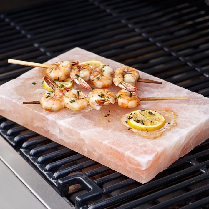 Want a beautiful AND functional Christmas gift? This  Pink Himalayan Salt Plate  is the most unique gift to give to the person in your life that loves to cook! This plate is sourced from natural salt deposits found in the Himalayas and its crystalline composition adds complex flavor to all types of foods. Wondering how to use it? Heat on the grill to sear seafood and meat, or chill for serving a selection of fruits, vegetables and cheeses with a hint of salt. Talk about a beautiful presentation!
