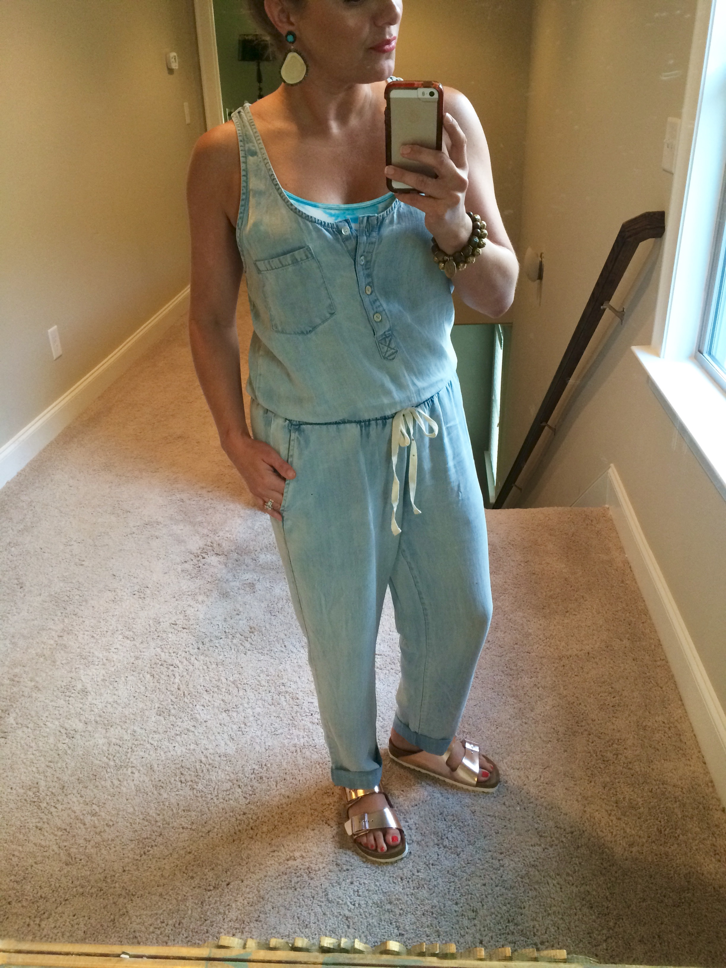 Styled in a casual way with Birkenstocks and fun colored bralette underneath!