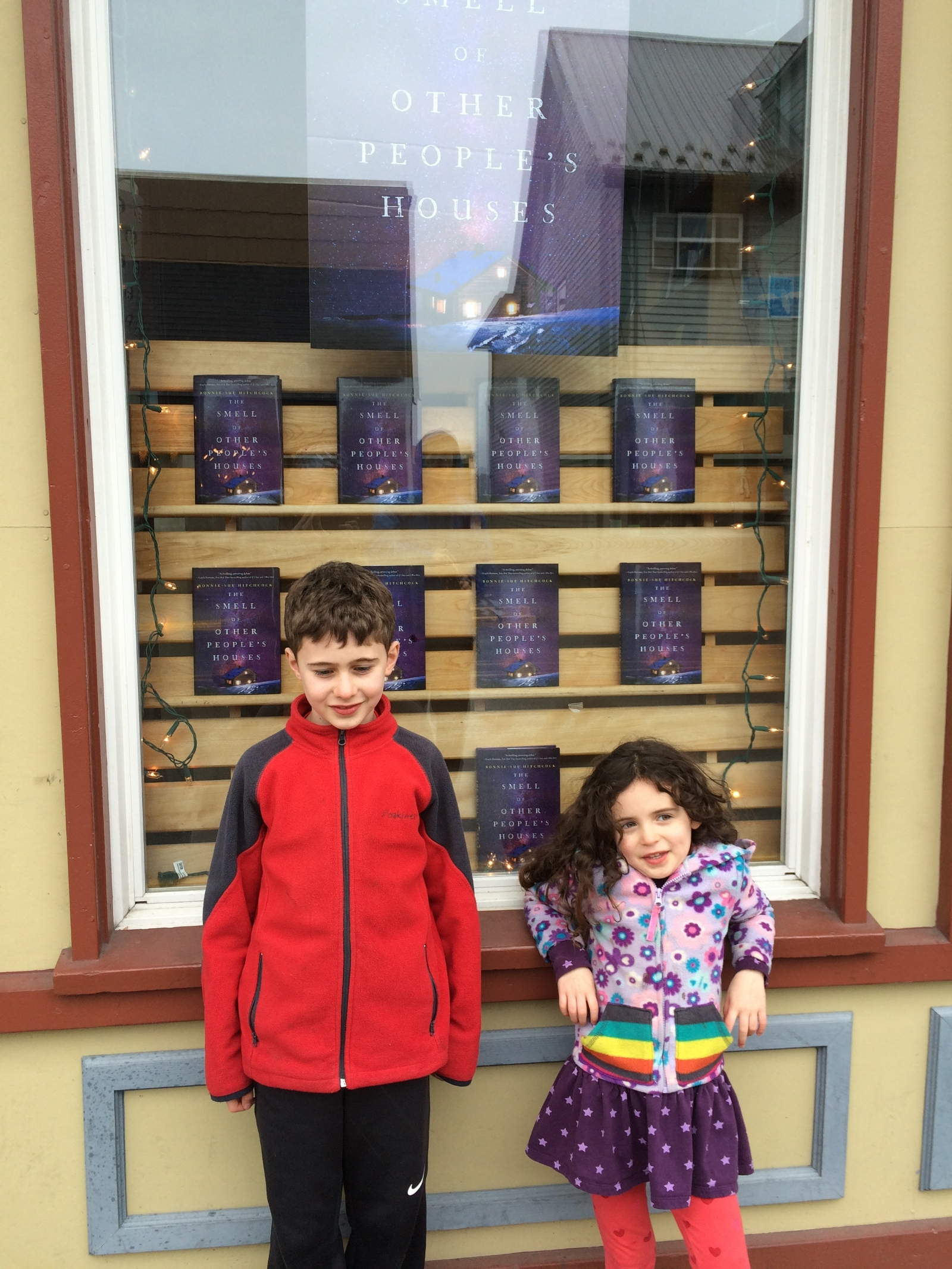 My niece and nephew in front of window display at Old Harbor Books, Sitka Alaska