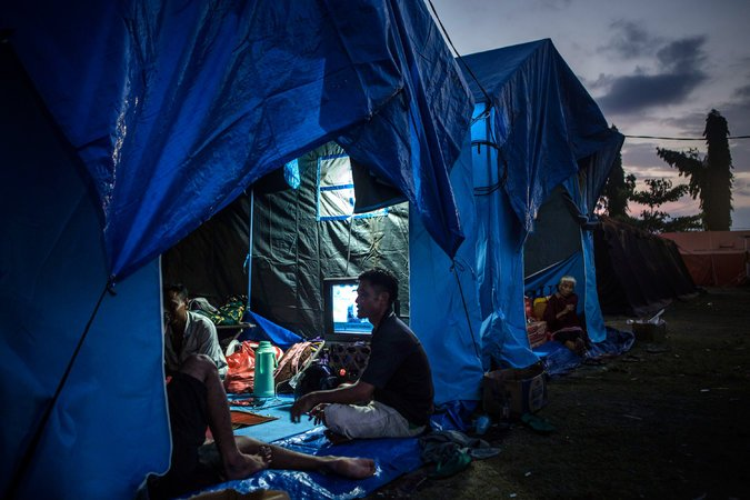 Sheltering in tents in Klungkung on Thursday.CreditUlet Ifansasti/Getty Images