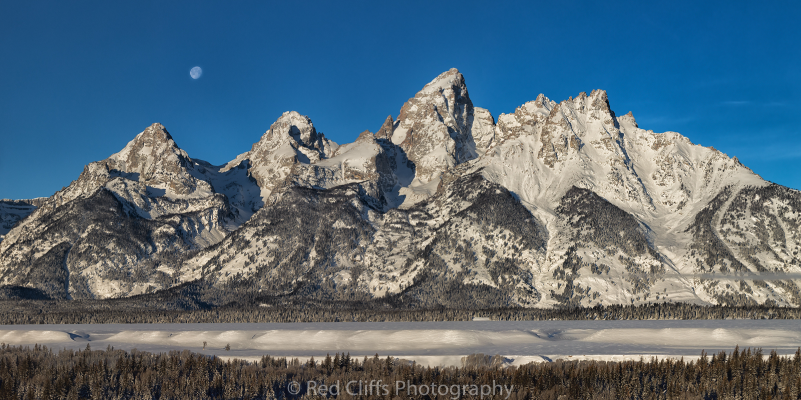 Moon setting the next morning over the Tetons