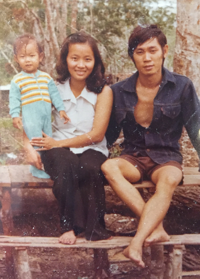 Mr. Mak, Mrs. Mak, and their daughter Frances in a refugee camp in Laos in the 1970s.