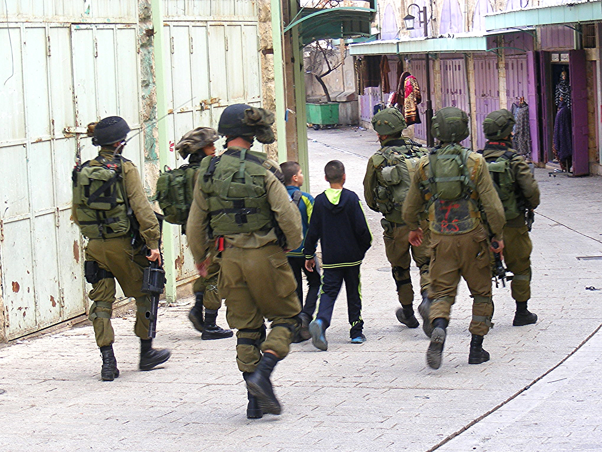A 10- and 11-year-ols are arrested for allegedly throwing stones. Under Israeli Military law, no one under 12-years-old may be arrested.