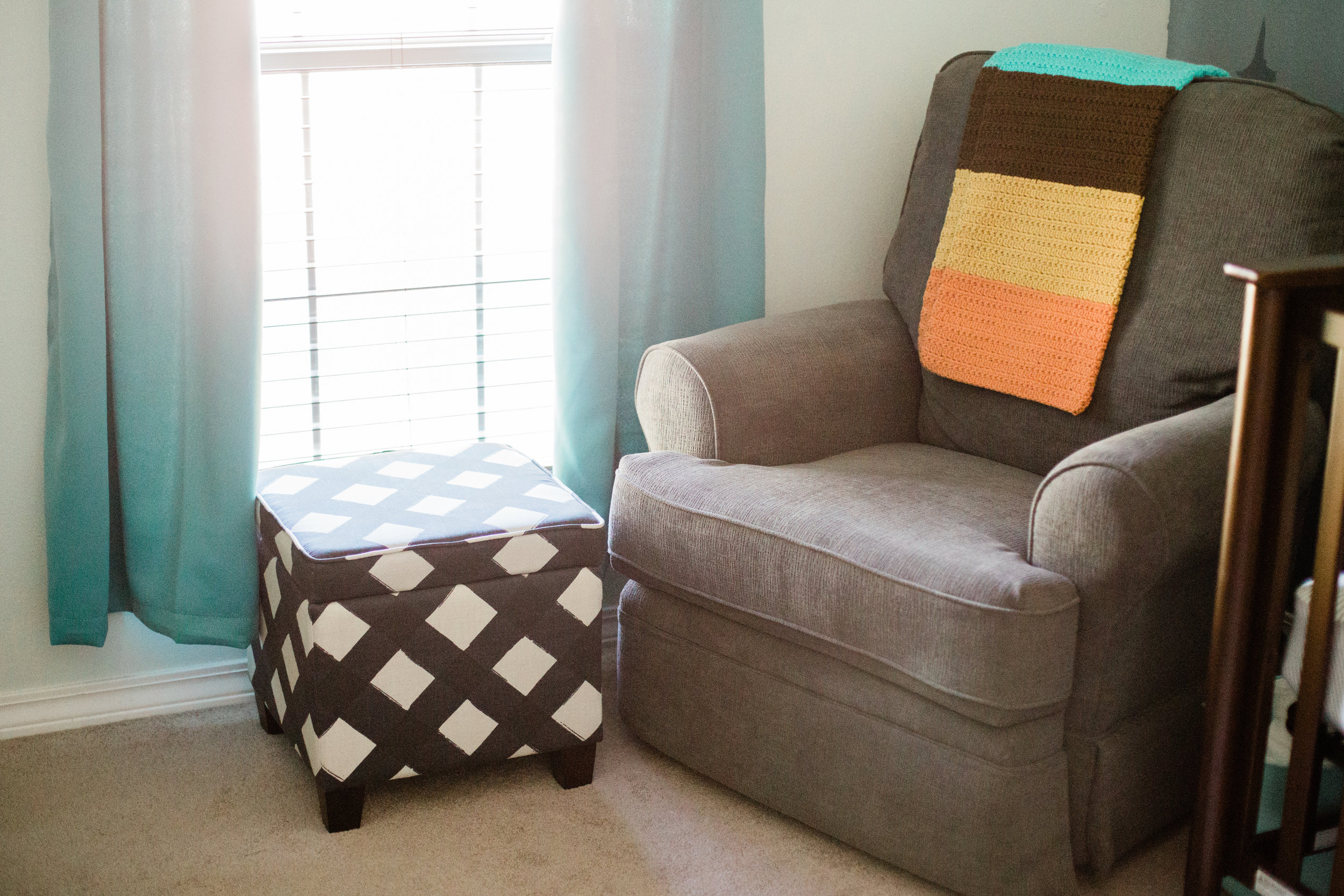 I'm loving this ottoman I got on clearance at Target (I'm using it to store my breast pump and pumping accessories)!
