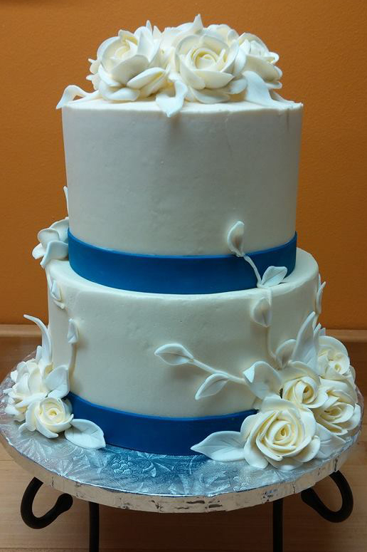 White with blue accents and roses