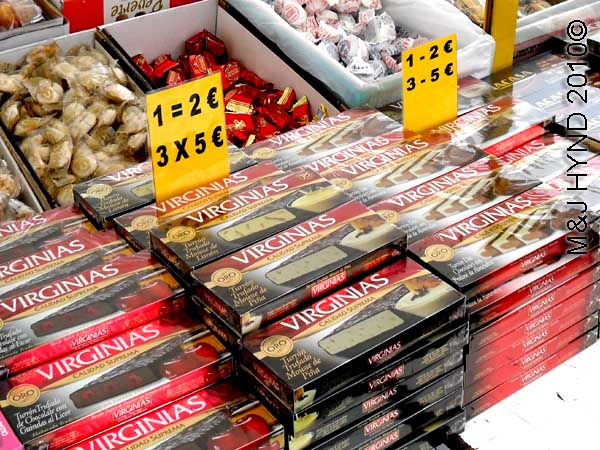 santapola market turron: spain santa Pola Saturday market flavoured turron nougat, individually wrapped sweets