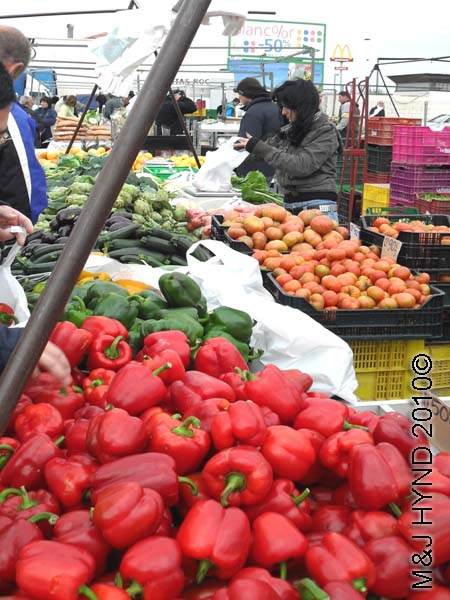 santa pola market red peppers: spain santa Pola Saturday market, red green peppers, courgettes, tomatoes