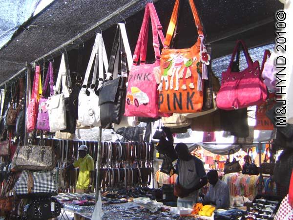 spain santa Pola Saturday market shopping for belts, sling handbags