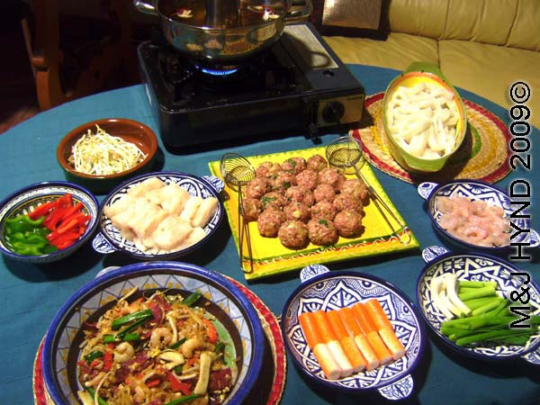 spain perleta fiesta nochevieja New Years Eve, steamboat with steaming broth squid, meatballs, char koay teow, prawn, greens