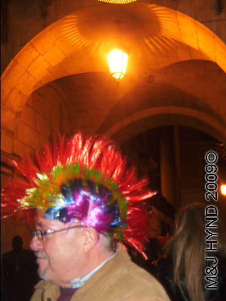 spain downtown Alicante, fiesta nochevieja New Years Eve, revellers, multi-coloured mohawk