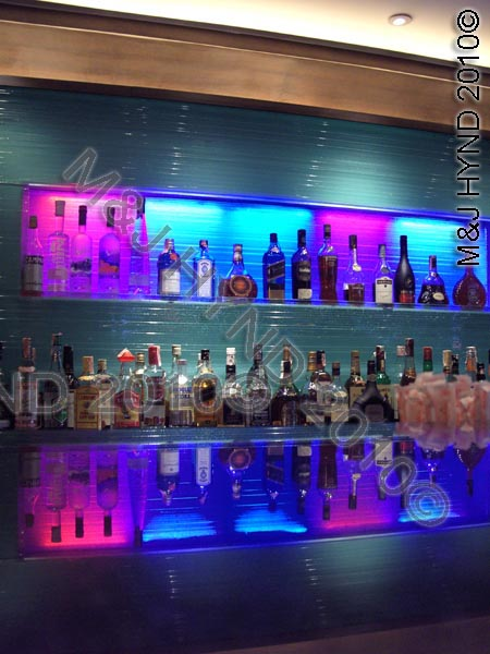 wellington: NZ, Lambton Quay, Wellington, Wine Bar floating, backlit light glass panel, creative, glass shelves, glass counter reflection, LED colour panels, custom design