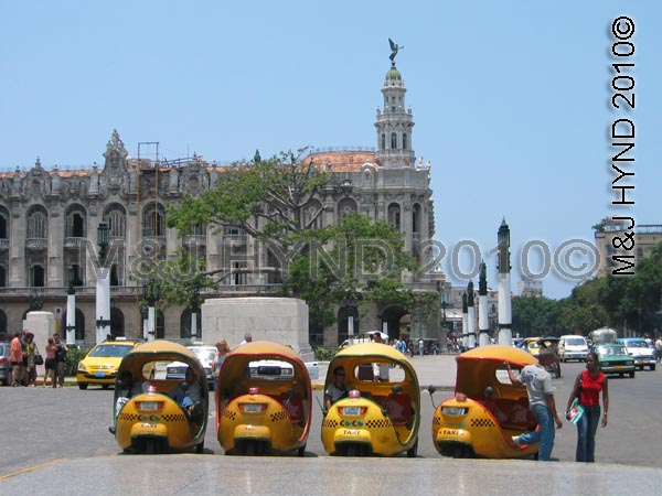 havana: coco-taxis, egg-shaped, three-wheeler in the shape of a yellow coconut, downtown Havana city, cuba, worldwide holiday ideas