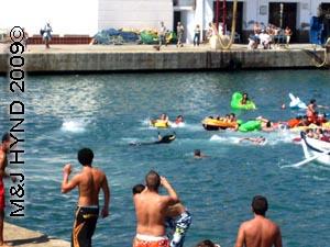 bull in the water: spain Javea Fiesta, Bous a la Mar, bullring Javea port, bull in sea, chasing lilos