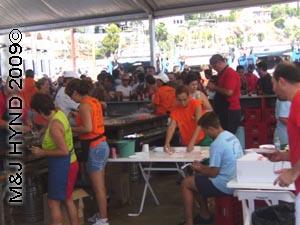 cooking seafood: spain Javea Fiesta, Bous a la Mar, bullring Javea port, festivities tent, cooked seafood, beers