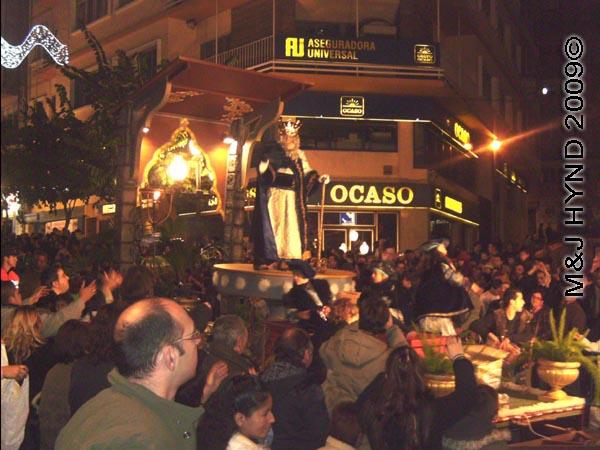 OCASO / parade#3: Spain Alicante Los Reyes Magos Three Kings' Fiesta Spanish Epiphany Christmas season, marching band, holiday parade float carry three wise men