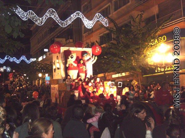2 red balloons on float / parade #6: Spain Alicante Los Reyes Magos Three Kings' Fiesta Spanish Epiphany Christmas season, holiday parade, spectators, float Chinese pandas