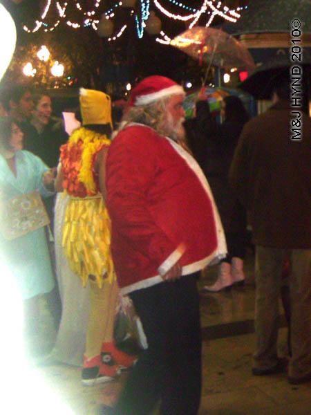 santa: spain Alicante Carnival Fiesta, Costa Blanca, Santa Claus costume, chicken costume, festive cheer