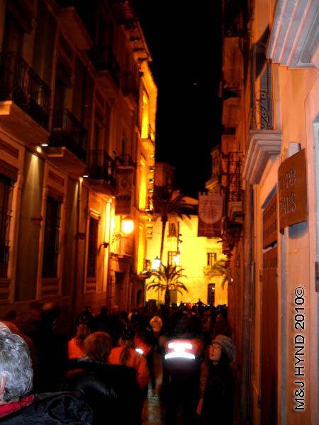 narrow street shot / medieval #3: spain Alicante Carnival Fiesta, Costa Blanca, harlequin costume, court jester, strolling troubadours, medieval music spectators, narrow alleyway, plaza