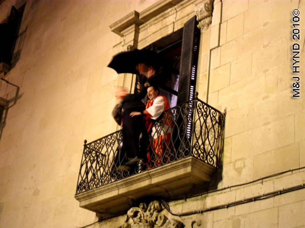 puppet about to be thrown / mediaeval #4: spain Alicante Carnival Fiesta, Costa Blanca, at the plaza condemned man about to be thrown from upper window