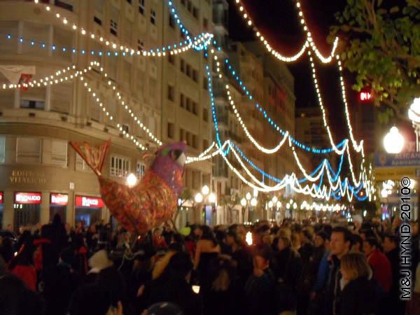 sardine #2: spain Alicante Carnival Fiesta, Costa Blanca, doomed sardine carried through darkened streets by throng of people, festive lights