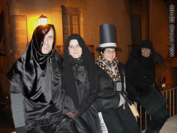 black mourners: spain Alicante Carnival Fiesta, Costa Blanca, darkened street, dressed in black, in mourning, top hat and tails