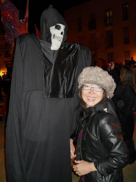 Jacq with grim reaper: spain Alicante Carnival Fiesta, Costa Blanca, darkened street, dressed in black, meet Grim Reaper