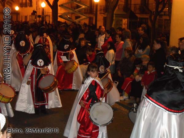 spain elche, Brotherhood black hood, long capes, procession, young marching drummer bands, near Townhall, crowded street parade