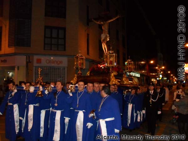 spain Alicante, Semana Santa Holy Week, Maundy Thursday procession, Brotherhood long blue capes, paso-bearers religious floats, silver Jesus's sculpture, somber march