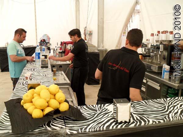 bar: spain perleta maitino St Vicente de Ferrer Fiesta, lage plate of lemons, huge beer bar, coffee machine, beer taps