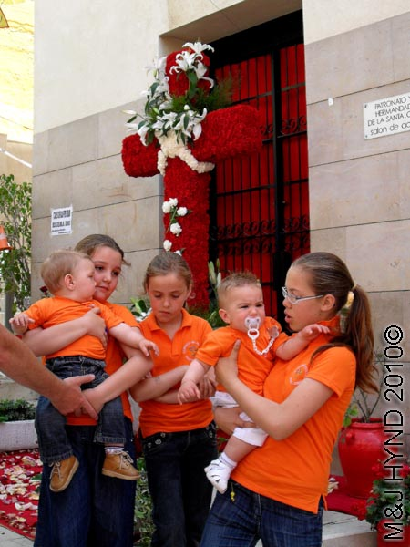4 girls: spain, Alicante Santa Cruz Fiesta, festive buntings, red fresh flowers decorated Crosses, red decorations village home