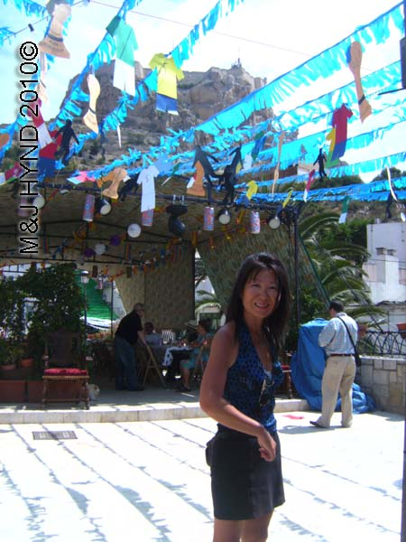 Jacq with blue bunting: spain, Alicante Santa Cruz Fiesta, Castillo Fortaleza de Santa Barbara, open-air square, festive buntings