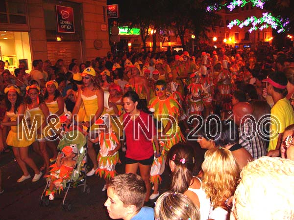 charanga / chickens: spain elche Fiesta fun parade, procession fiesta-goers disguises Charanga, dressed as chickens, festive streetlights, crowds