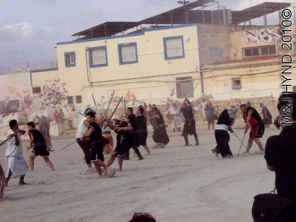 moors invade beach: spain Santa Pola Annual Fiesta, mock Moorish invasion, battles on beach