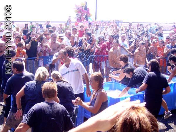 beer bath: spain Santa Pola Annual Fiesta, Santa Pola port, free beer bath, crowds