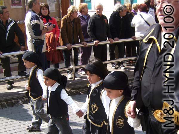 four little guys with black headbands: spain Santa Pola Annual Fiesta, four little guys with black headbands