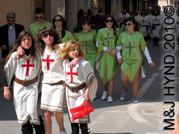 christians red+whi, as well as green: spain Santa Pola Annual Fiesta, Christians costumes parade