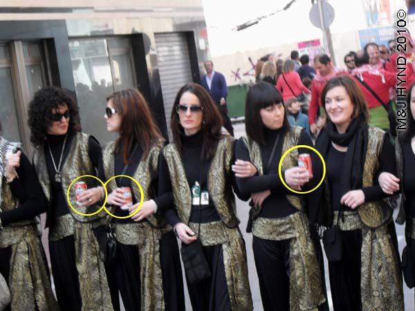 ladies with Amstel beer cans: spain Santa Pola Annual Fiesta, Moorish costumed ladies parade